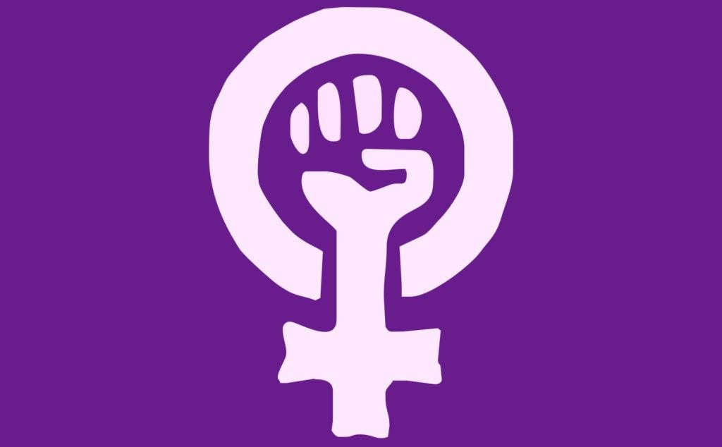 Символ феминизма: сжатый кулак - борьба, зеркало Венеры - символ женщины, традиционный лиловый цвет