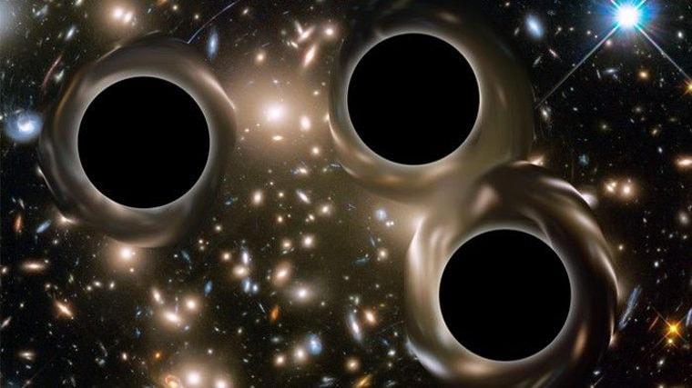 Астрономы увидели системы трех огромных черных дыр