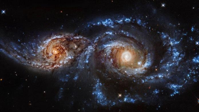 Если вселенная расширяется, то почему галактики сталкиваются?